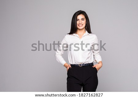 Portrait of young busineswoman standing.Over white background.