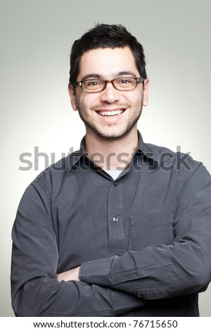 Portrait of young casual man with glasses smiling #76715650