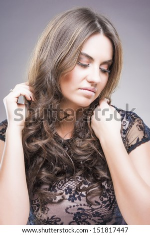 Portrait of Young Caucasian Brunette with Sad Facial Expression over gray background. vertical shot