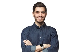 Portrait of young Caucasian man feeling happy and smiling, wearing smart watch and casual clothes, isolated on white background