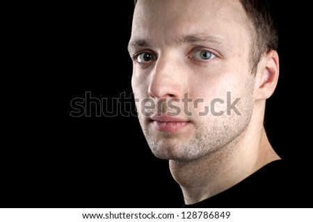 Portrait of young Caucasian man isolated on black background