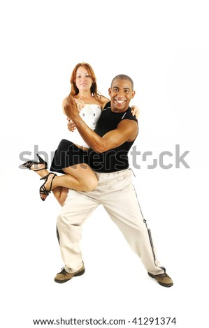 Portrait of young couple dancing, latino dance instructor carrying girl - isolated