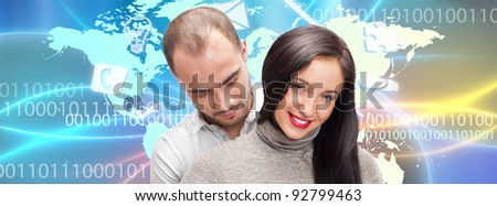 Portrait of young couple embracing. Standing against world map. International dating concept