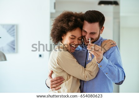 Portrait of young couple feeling happy about buying a new house.