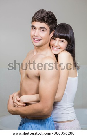 Portrait Of Young Couple Smiling And Cuddling Each Other In Bathroom 388056280
