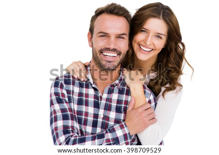Portrait of young couple smiling on white background #398709529