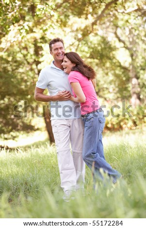 Portrait Of Young Couple Walking In Park
