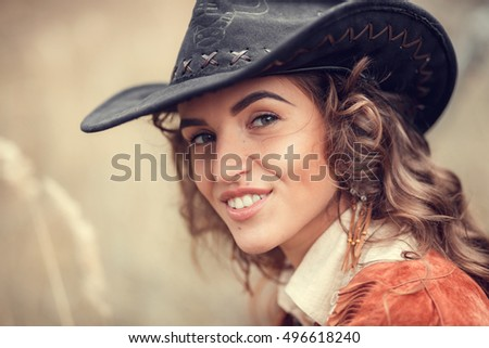 portrait of young cowgirl...