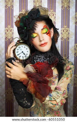 Portrait of young creative woman with clock.