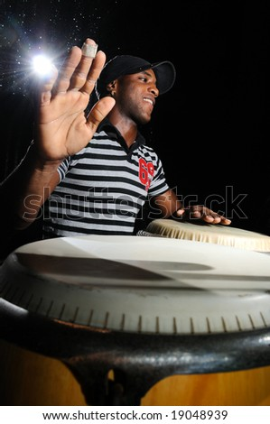 Portrait of young cuban percussionist performing live