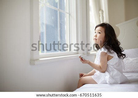 Portrait of young cute asian little girl #670511635