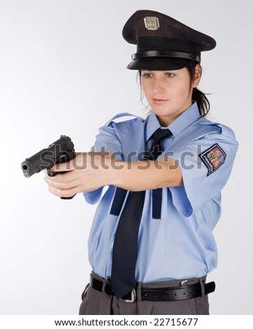 Portrait of young czech police woman in photo studio.