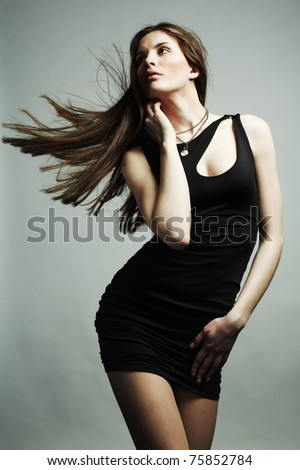 Portrait of young dancing girl with flying dark hair