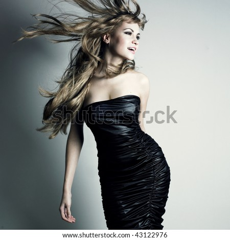 Portrait of young dancing girl with smart fair hair