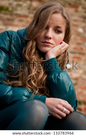 Portrait of young depressed woman outdoors -  autumn season
