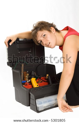 Portrait of young despondent brunette with toolbox
