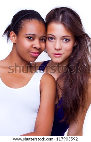 portrait of young different nationalities teenage girlfriends, caucasian woman and african american woman - isolated on white background