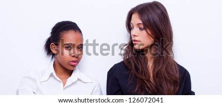 portrait of young different nationalities teenage girls, caucasian woman and african american woman