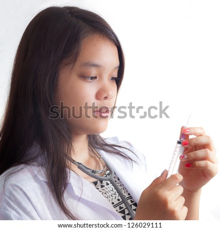 Portrait of young doctor against white background