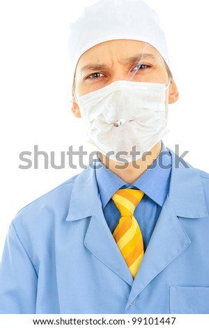 Portrait of young doctor wearing uniform smoking through the breather. Doctor against smoking concept. Smoking causes diseases.