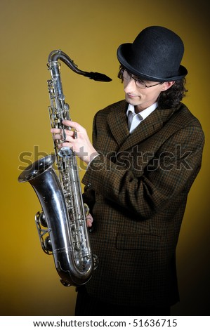 portrait of young english gentleman in bowler hat playing saxophone. yellow background