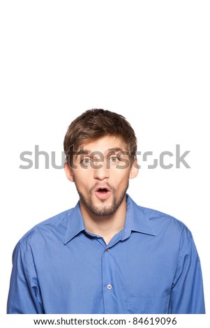 Portrait of young executive looking very surprised astonished businessman, isolated over white background, series of photos.