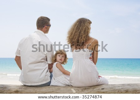 Portrait of young family having fun on the beach