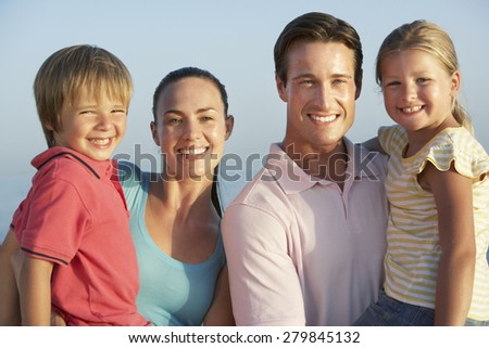 Portrait Of Young Family On Beach Holiday #279845132