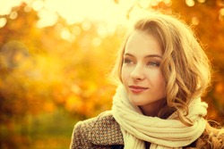 Portrait of Young Fashion Woman Outdoor on Autumn Background. Toned Photo with Bokeh and Copy Space.