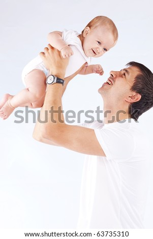 Portrait of young father with his baby daughter