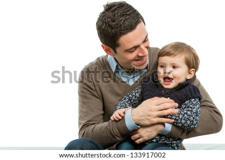 Portrait of young father with his baby daughter.isolated.