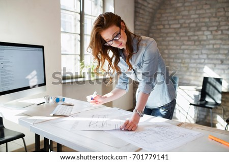 Portrait of young female architect working on project #701779141