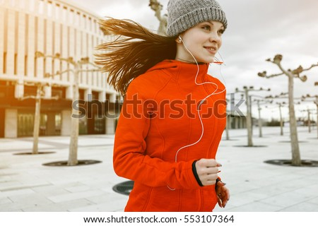 portrait of young female runner ...