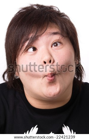 portrait of young female teenager making funny faces