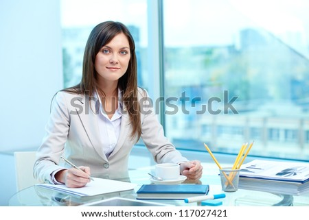 Portrait of young female writing proficiency test