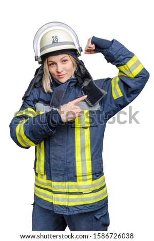 Portrait of young firefighter woman in helmet and wears an uniform, looking at camera and showing her biceps.Isolated on white background. I can do anything concept