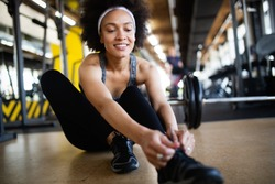 Portrait of young fitness woman in gym