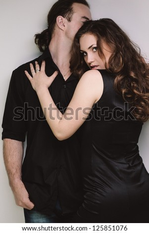 Portrait of young flirting couple in casual clothing