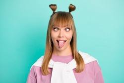 Portrait of young funky funny childish humorous girl stick tongue out with jumper on shoulders isolated on teal color background