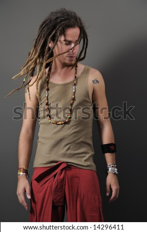 Portrait of young funky male with long dreadlocks