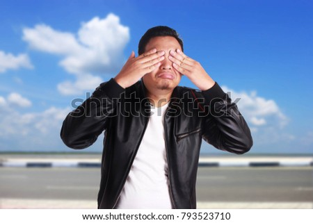 Sad Young Man On The Black Background Hide His Face Images