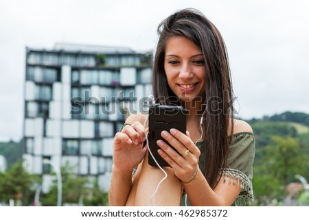Portrait of young girl browsing internet from her smartphone