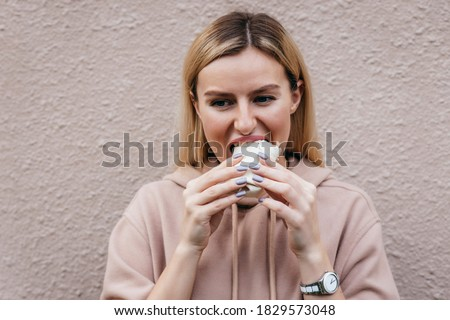 Portrait of young girl eating chicken roll on street Stockfoto ©