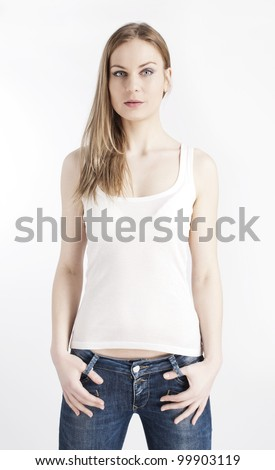 Portrait of young girl in a white top and denim jeans on a white background - stock photo