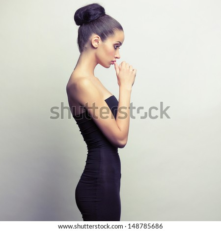 Stock Photo Portrait of young girl in black dress