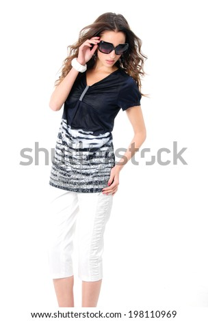 Portrait of young girl in fashion dress wearing sunglasses posing #198110969