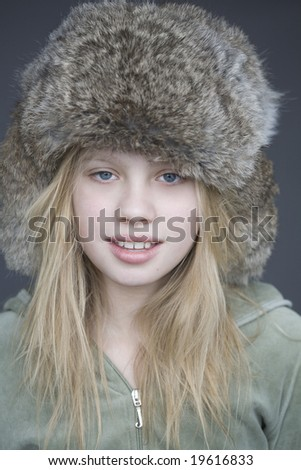 Portrait of young girl in fur hat