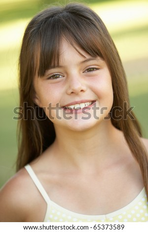 Portrait Of Young Girl In Park