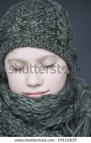 Portrait of young girl in winter apparel