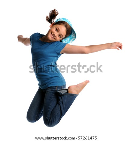 Portrait of young girl jumping isolated over white background